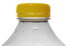 Water Bottle with Condensation. Water bottle with cold thirst quenching condensation dripping off of the edge of the plastic container Stock Photo