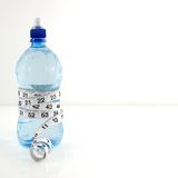 Water bottle diet concept. Measuring tape wrapped round water bottle. Copy Space. Health Concept Stock Photo