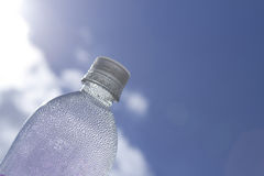 Water bottle droplets in the sky Royalty Free Stock Photo