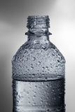 Water bottle with drops Royalty Free Stock Images