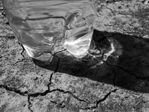 Water bottle on dry ground Stock Image