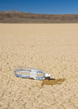 Water bottle on Dry Lake, Nevada Royalty Free Stock Images