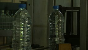 Water_bottle in factory stock video