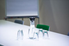 Water bottle and glasses in meeting room Royalty Free Stock Photography