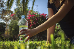 Water bottle on grass Royalty Free Stock Photos