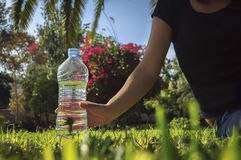 Water bottle on grass Stock Photography