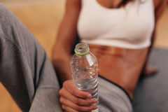 Water bottle in hand of a fitness woman Stock Photo