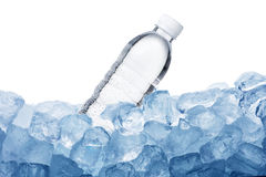 Water Bottle on Ice Cube. Water Bottle and Ice Cube on white background Stock Photo