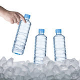 Water Bottle on Ice Cube Royalty Free Stock Photos
