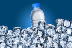 Water Bottle and Ice Cubes Royalty Free Stock Image