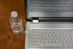 Water bottle with laptop Stock Photo