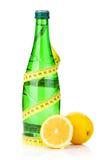 Water bottle, measuring tape and fresh lemons Stock Photo