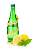 Water bottle, measuring tape, lemon and mint Stock Images