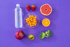 Water bottle, measuring tape, various fruits, vegetable and diet breakfast Stock Images