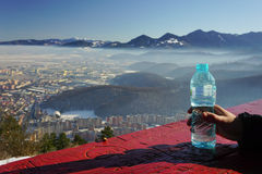 Water bottle and mountains Stock Image