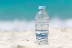 Water in bottle on sand Stock Photography