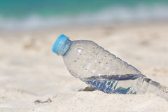 Water in bottle on sand Stock Photo