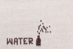 Water bottle sign from coffee beans on linea canvas, aligned bottom-left stock photography