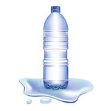 Water bottle in spilled water Royalty Free Stock Images