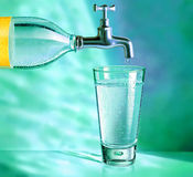 Water bottle with tap and water glass. Water bottle with tap, placed over a water glass vector illustration