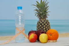 Water bottle, tapeline mix fruits Stock Photography