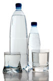 Water on bottle and two cup Royalty Free Stock Image