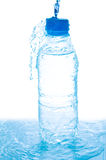 Water from bottle on white. Pouring water from bottle on white Royalty Free Stock Photo