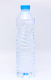 Water bottle on white background.Half a bottle of water Stock Images