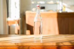 Water bottle. On the wooden table Royalty Free Stock Images