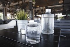 Free Water Bottle Woth Glass On The Table Of Cafe In Athens Stock Photos - 209099563