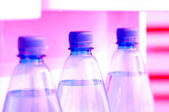 Water bottles 1. Three mineral water bottles on a refrigerator's door. Custom WB was used for a colder look Stock Photo