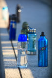 Water Bottles. Colorful water bottles waiting to be drunk by tired athletes Stock Images