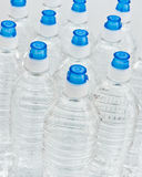 Water Bottles. Multiples of water bottles with blue caps Stock Photos