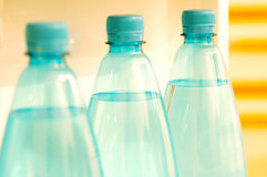 Water bottles 2. Three mineral water bottles on a refrigerator's door. Custom WB was used for a warmer look Royalty Free Stock Images