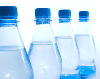 Water bottles. Four water bottles with depth of field on white background Royalty Free Stock Photo