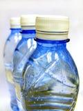 Water bottles. Three water bottles on white background Royalty Free Stock Photo