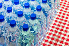 Water bottles. Bunch of plastic water bottles with blue lids Stock Photo