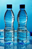 Water bottles. On blue background Stock Photo