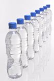 Water bottles from above. A row of eight water bottles viewed from above Royalty Free Stock Photos