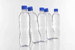 Water bottles angled. Five water bottles with two at an angle Royalty Free Stock Photos