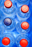 Water Bottles in Blue Containe. A lot of water bottles with red and blue caps placed in a cooling box. Suitable for camping, outing, picnic, etc. projects Stock Image