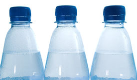 Water bottles closeup. Closeup of three water bottles on white background Royalty Free Stock Photography