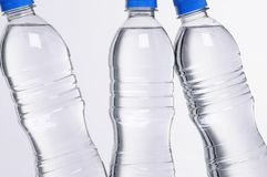 Water bottles closeup. Closeup of three water bottles with blue lids Royalty Free Stock Image