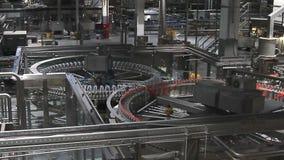 Water bottles on conveyor or water bottling machine stock video footage