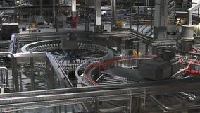 Water bottles on conveyor or water bottling machine stock footage