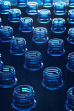 Water bottles in factory. Portrait of plastic water bottles in factory with even depth of field Stock Photo