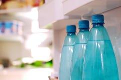 Water bottles in fridge royalty free stock photography