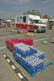 Water bottles in front of Red Cross truck Stock Image