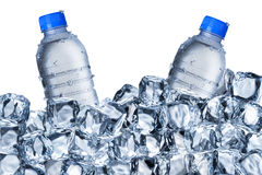 Water Bottles and Ice Cubes. Water bottles with ice cube on White Background Stock Photography