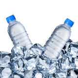 Water Bottles and Ice Cubes. Water bottles with ice cube on White Background Stock Images